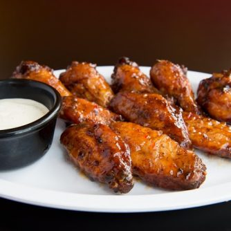 Your choice of 10 or 20 Blazin' Hot, Buffalo, BBQ, Swt. Chili, Teriyaki or Plain w/Ranch or Blue Cheese dressing.